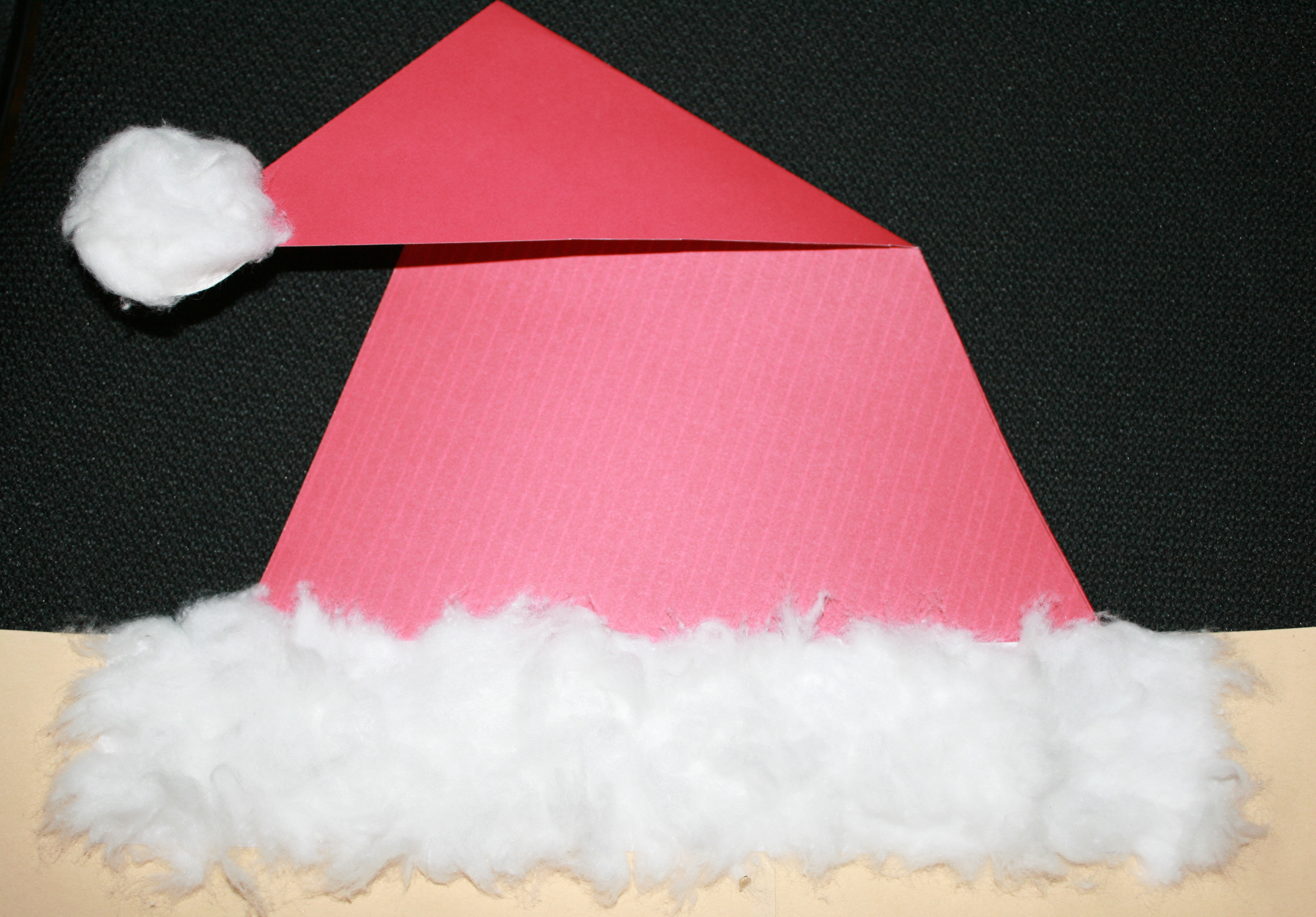 Santa's fur hat, cylinder shape, 3D shapes, art projects with shapes, Santa windsock, windsocks, Christmas crafts for kids, keepsake crafts, handprint art, handprint crafts, handprint Santa, cylinder art projects, handprint art projects, December activities, Santa activities, Christmas gifts kids can make
